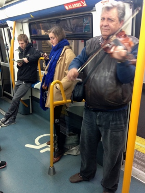 Sneaky shot of the violinist who plays the same 2 songs on the Metro - 1/31/15